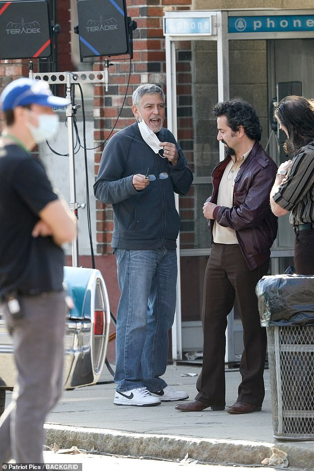 Calling the shots: George Clooney was spotted on the location set of the drama the Tender Bar on Thursday. He was directing scenes with actor Max Casella in the Boston suburb of Beverly