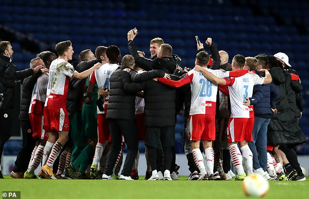 Slavia players celebrate at full-time after progressing to the Europa League quarter-finals