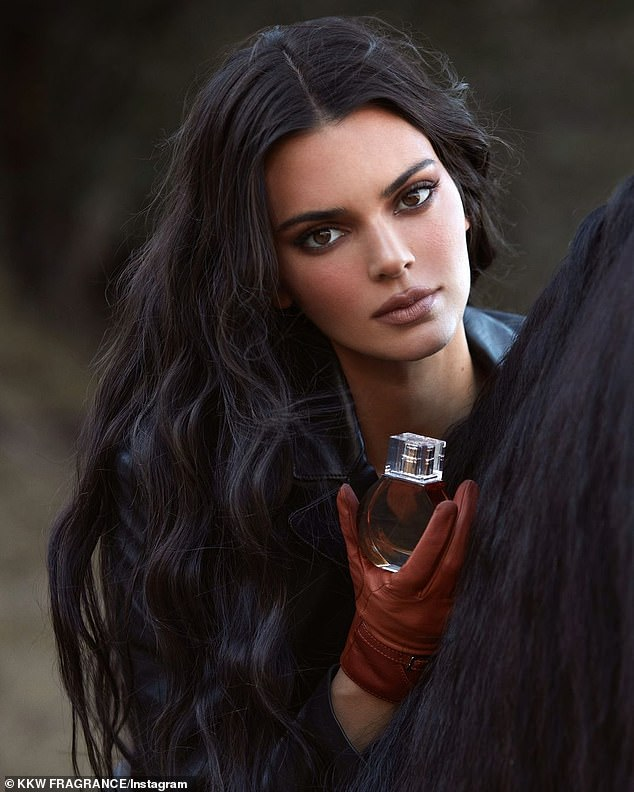 Her partner in scent: Kim launched the new line with her half sister Kendall Jenner