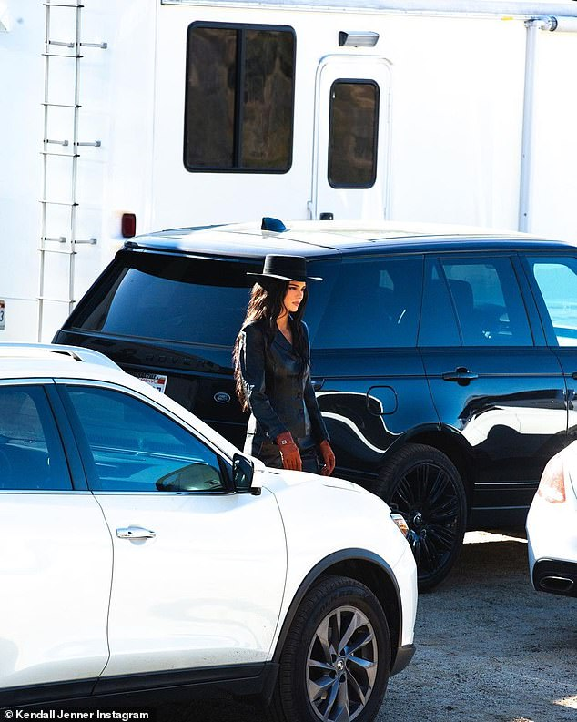 She has the look: Kendall was stunning in this hat as she was seen on set with gloves on