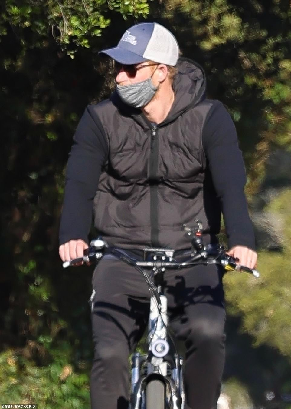Harry left his wife and son at home when he was spotted briefly enjoying a ride alone with his security