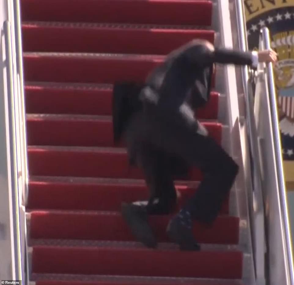 New questions over Biden's health as the president, 78, stumbles multiple times up the stairs of Air Force One before falling down