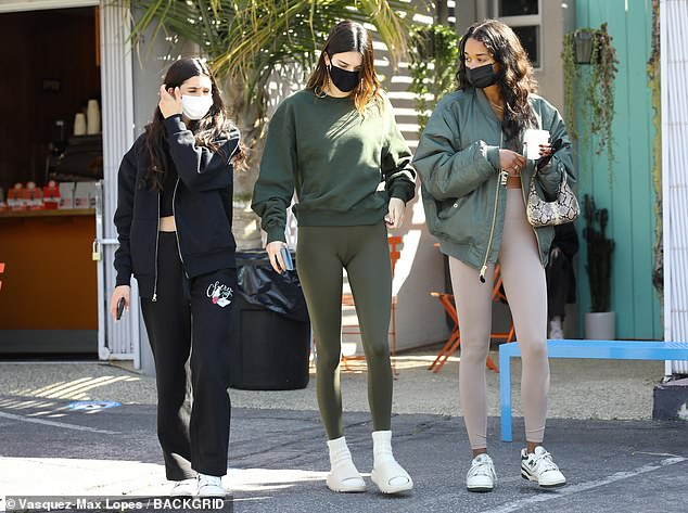 Staying protected: Jenner and her friends all wore facial coverings to keep themselves safe while spending time in public