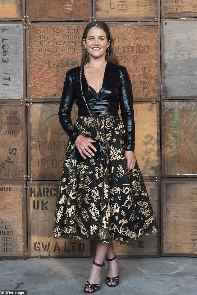 All in the detail: She teamed the look with a black midi length skirt that had the designer's name, Jason Grech, written all across it in sparkling gold