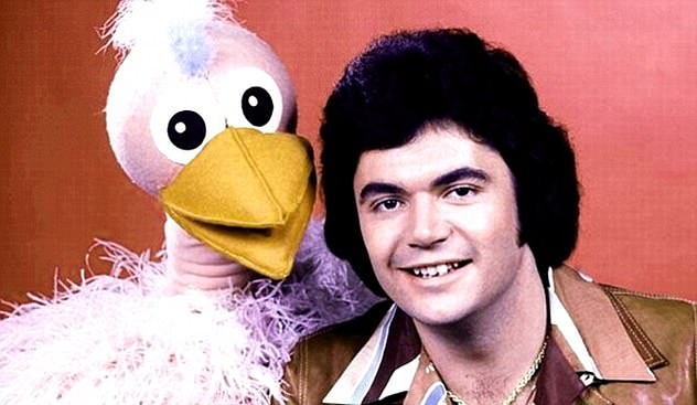 He said: 'You probably could not get away with half the stuff you could on Hey Hey now because of the political correctness and the cancel culture. It is a shame because showbiz does not get much of a chance.' Pictured onu00A0Hey Hey It's Saturday with mascotu00A0Ossie Ostrich