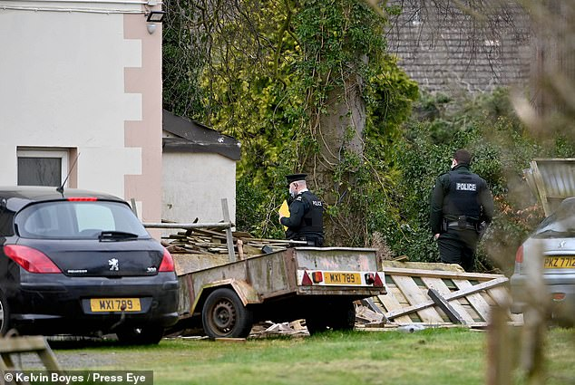 Police and the ambulance service were called to the scene where a woman was found dead. Pictured: Police\u00A0at the scene on March 20