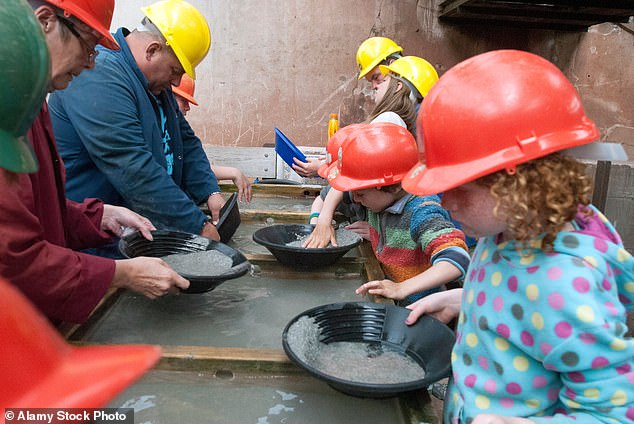 Geevor Tin Mine has tunnels extending out under the sea. Pictured are visitors panning for minerals