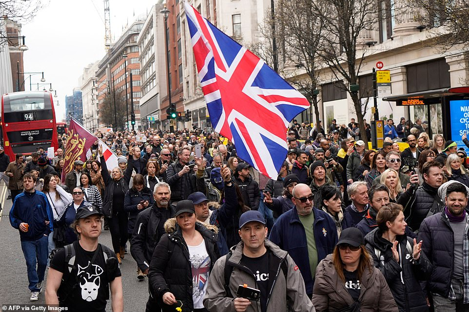Some carried large Union Flags as they descended on the streets and clogged up roads during the maskless protest on Saturday