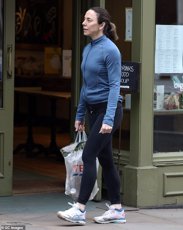 Stocking up:u00A0The singer sported a blue running jacket and black leggings as she picked up a bag of essentials on the outing