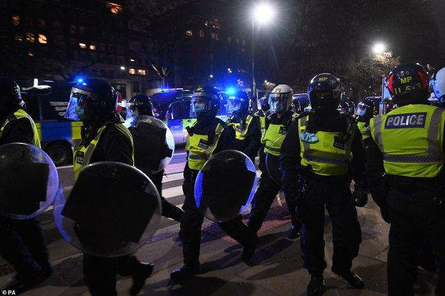 Riot police were still out in force on the streets of the capital tonight as pockets of protesters continued to gather