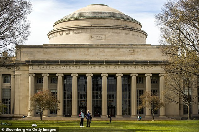 People stand on the lawn outside Building 10 on the Massachusetts Institute of Technology campus in Cambridge, Massachusetts
