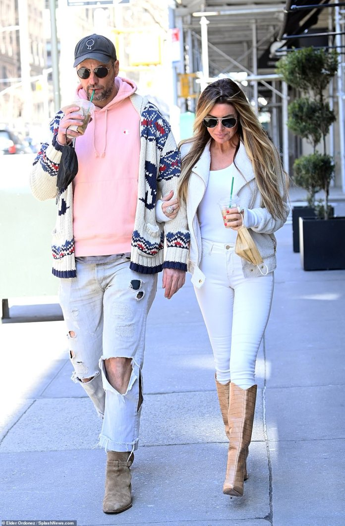 Summer coming: For one walk, Uchitel got a jump on spring fashion by striking a casual but chic figure in an all-white ensemble: consisting of skin-tight white pants and a matching shirt