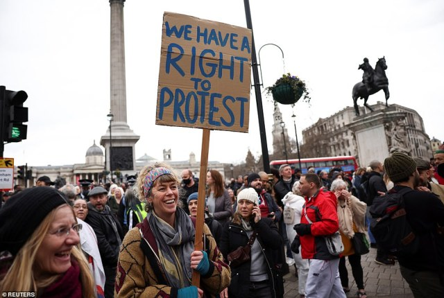 A person holds a sign during a protest against the lockdown, amid the spread of the coronavirus disease in London