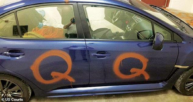 The image above released by the US Department of Justice shows a blue 2016 Subaru that was allegedly driven by Ian Alan Olson of Waukesha County, Wisconsin. The letter 'Q' is spray painted on the two doors seen above