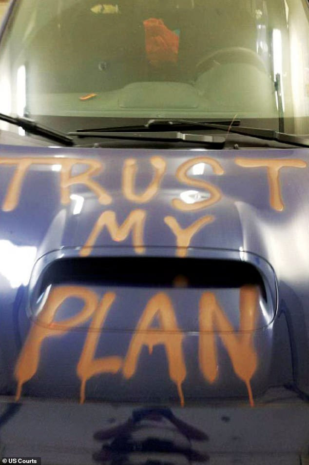 According to federal authorities, Olson is a supporter of the QAnon conspiracy theory whose followers believed that on March 4 Donald Trump would reclaim the presidency. The image above shows the phrase 'Trust My Plan' spray painted on Olson's car, the federal government alleges
