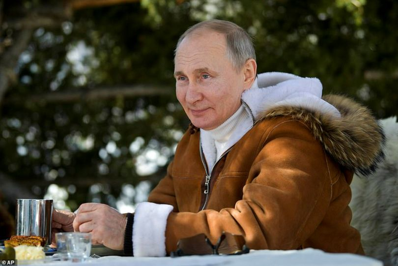 Vladimir Putin was seen dressed in a sheep skin to go on manoeuvres in Siberia with his defence minister after releasing his latest 'hit list' of opponents