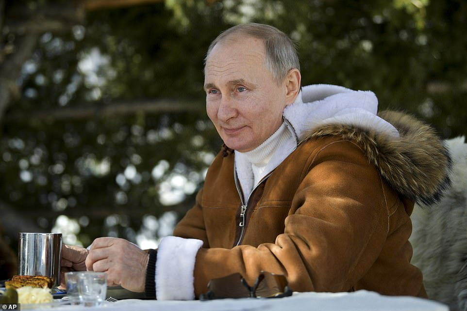 Vladimir Putin was seen dressed in a sheep skin to go on manoeuvres in Siberia with his defence minister