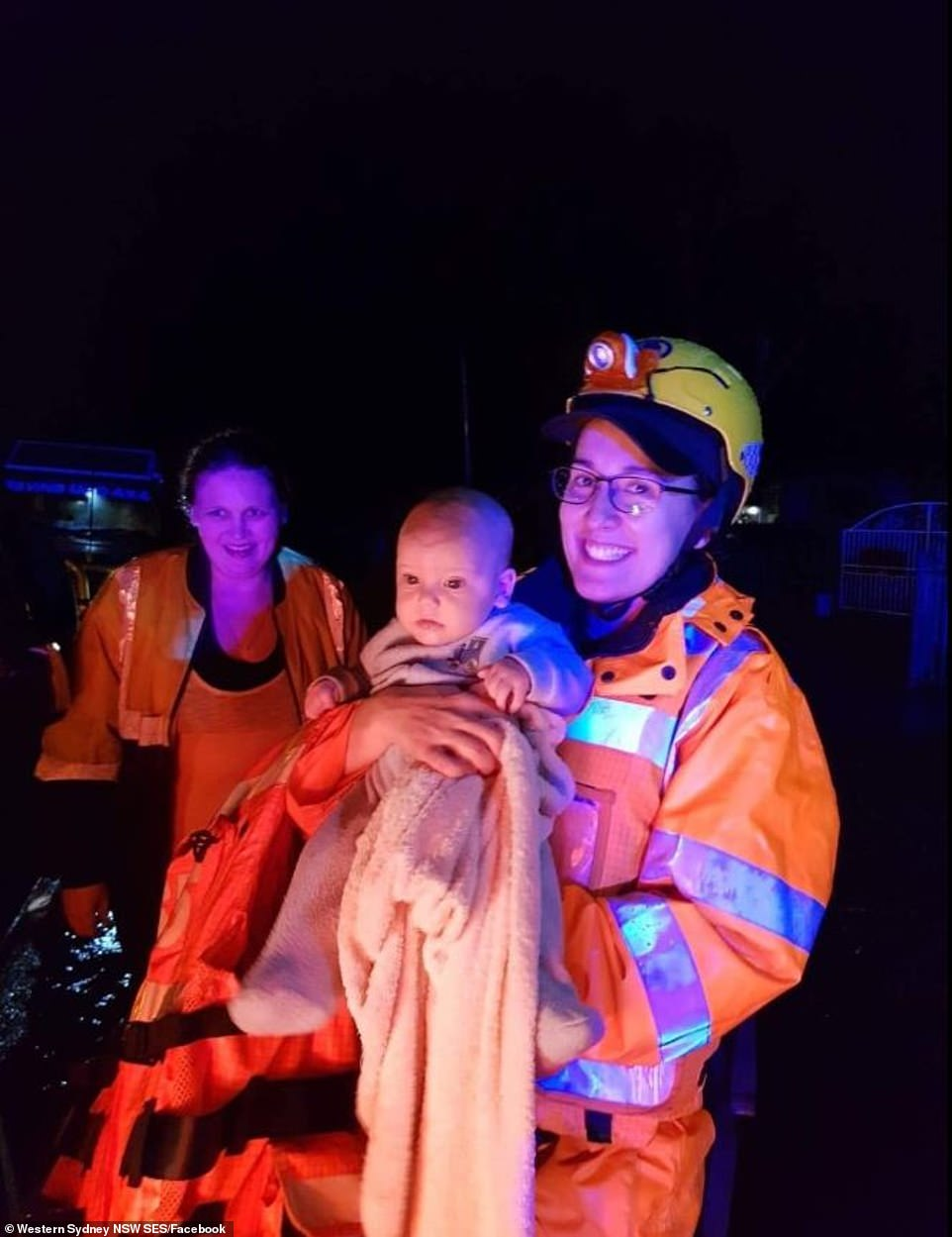 A baby is pictured with SES after they saved theu00A0the five-month-old infant, a child, four adults and three dogs inu00A0Londonderry