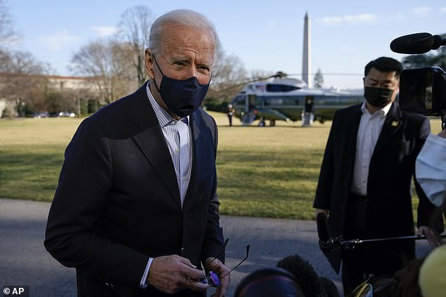 President Joe Biden (pictured) on Sunday said he planned to visit the US-Mexico border 'at some point' as his administration works to ensure potential migrants apply for asylum in their home countries