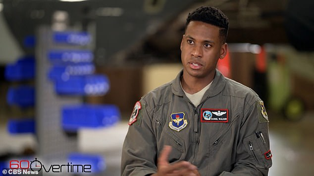 An Air Force fighter pilot, Maj Daniel Walker, pictured, who is the great-nephew of a decorated Tuskegee Airman, Norman Scales, has revealed that he was forced to leave the branch due to racism