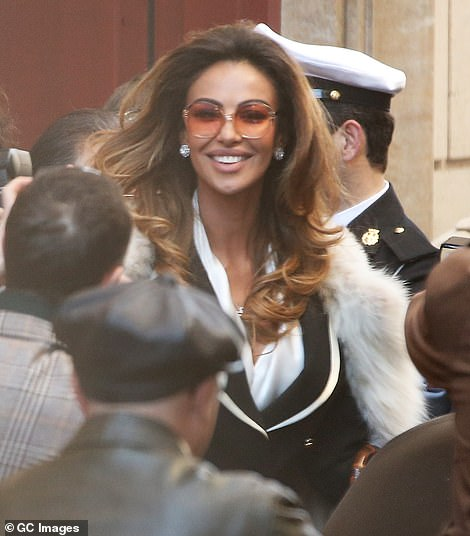 Attractive: The legendary actor was accompanied by statuesque co-star Mădălina Ghenea while shooting a crowded street scene