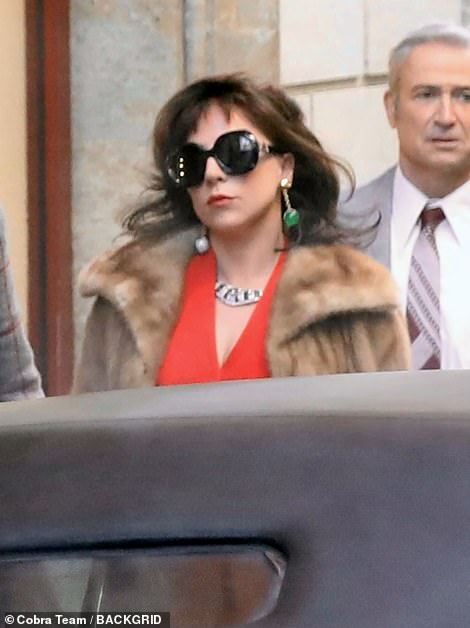 Shady: Gaga rounded off her look with a pair of heavily tinted sunglasses as she idled on set