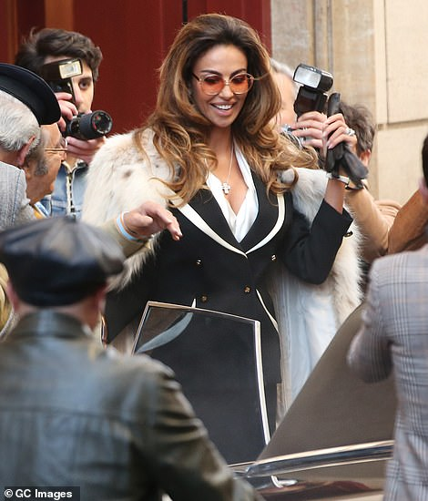 Make way: With extras playing the role of waiting paparazzi photographers, the actress appeared to playing the role of a high profile public figure