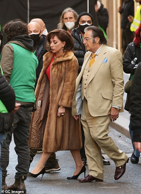 Let's talk: The singer and actress was later joined by Pacino as they mingled with the crew between takes