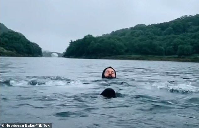Tik Tok content creator the Hebridean Baker posted a clip of his partner Peter, pictured, enjoying a wild swim in theClachan Sound off the Isle of Seil