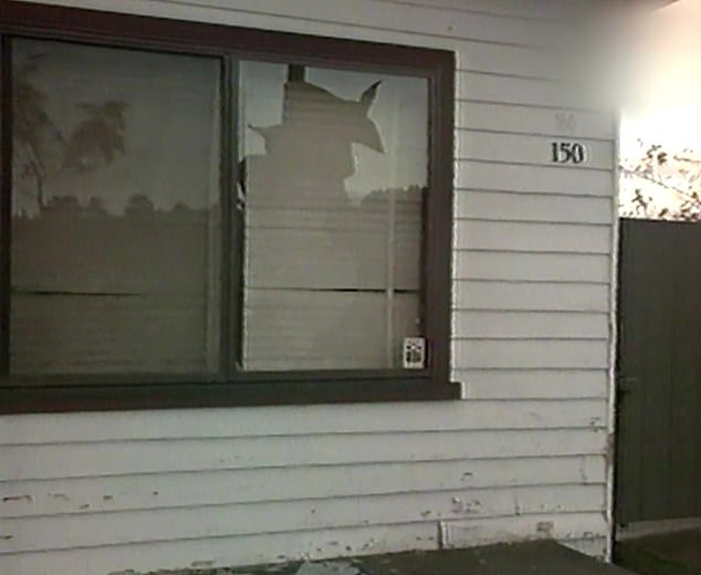Police did not fingerprint inside the house despite the windows being broken (pictured)