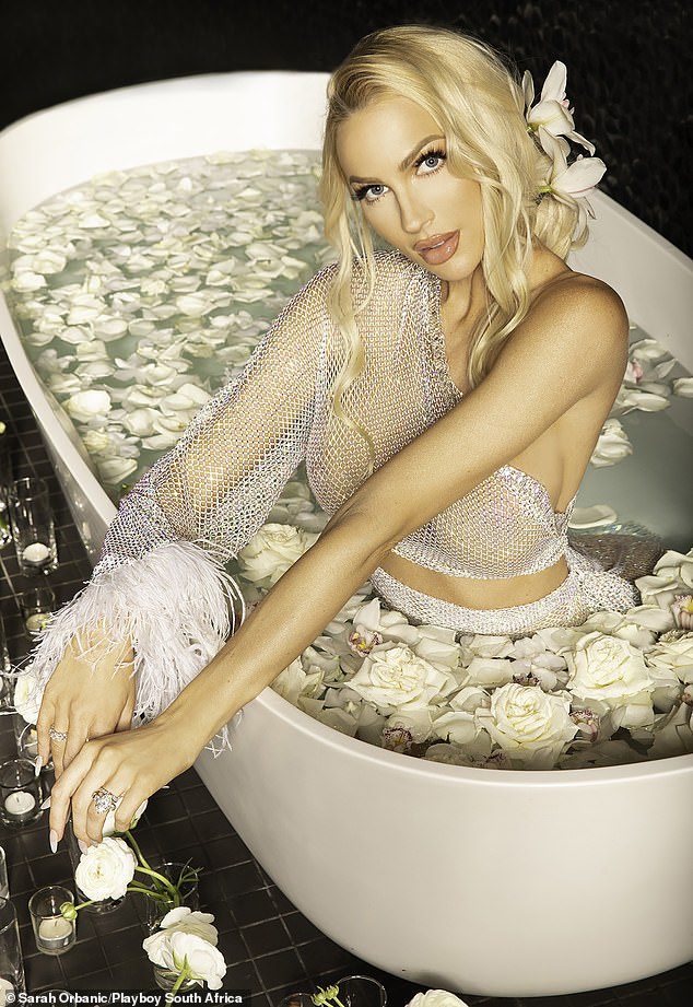 Watch her glow: Amping up the sex appeal, the real estate agent modelled see-through co-ords in a bath tub, which was covered in petals