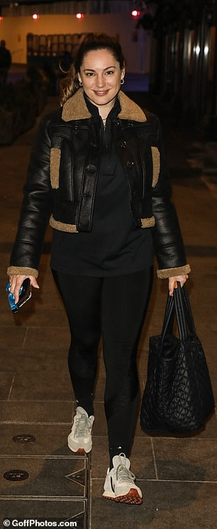 Out and about: The star accessorised her look with a small pair of gold hooped earrings, while she stored her essentials in a quilted back handbag