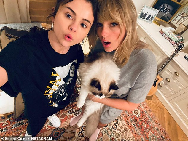 BFF: Selena Gomez, 28, shares snaps with bestie Taylor Swift, 31, as she writes 'kinda missin this one,' as they cozied up at home with Swift's cat Benjamin