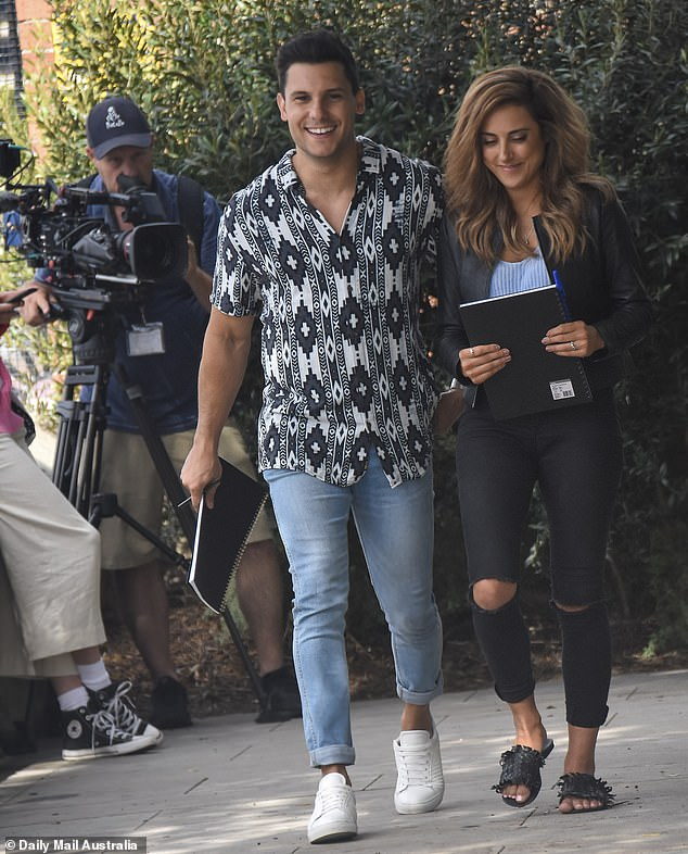 Spotted: The newlyweds couldn't wipe the smiles off their faces as they went out for a stroll and completed a Confessions Week task