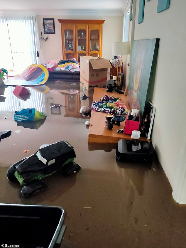 Water had risen so high by the time the family woke, they could not save their belongings
