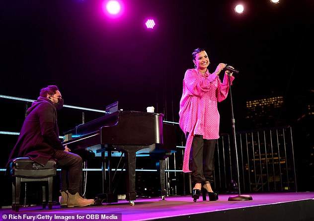 Best of all: After the screening, which was attended by starlet Kim Kardashian and beloved pastor Judah Smith, the pop star briefly left the balcony of her Beverly Hilton room to serenade the audience.