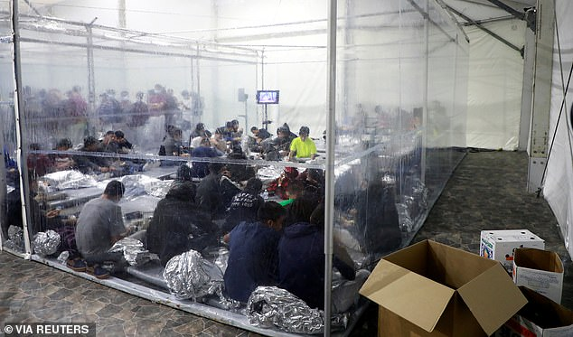 Another image is taken from the outside of a transparent tent looking in on the dozens of people packed inside