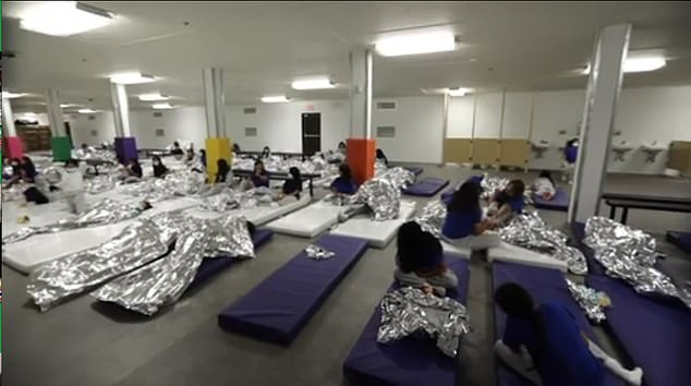 Video taken inside the facility in El Paso, Texas, shows migrants lying on mattresses on the floor with foil blankets