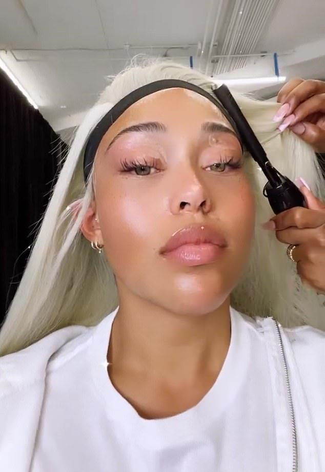 Primping: The first video showed Woods sitting back with her stylist hard at work with the caption: 'she's backkkkkk,' along with two pink heart emojis