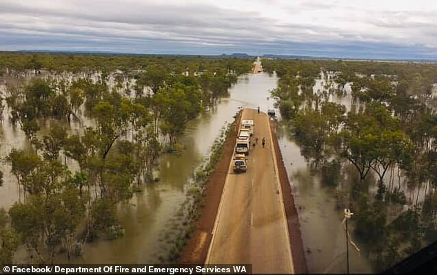 Nearly 2,000km of roads in Western Australia are inaccessible after being cut-off by floodwaters (pictured)