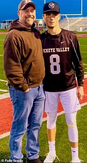 Stone Foltz with his dad, Cory