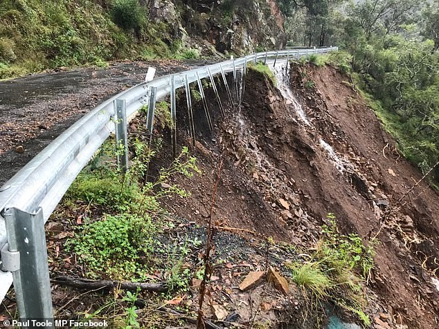 The cave's management said authorities would assess the road damage (pictured) and decide whether the road can be reopened after repair work