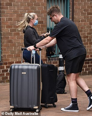 They've got their hands full! The couple kept low profiles as they checked into the Adina Apartment Hotel in Surry Hills with various luggage bags in tow