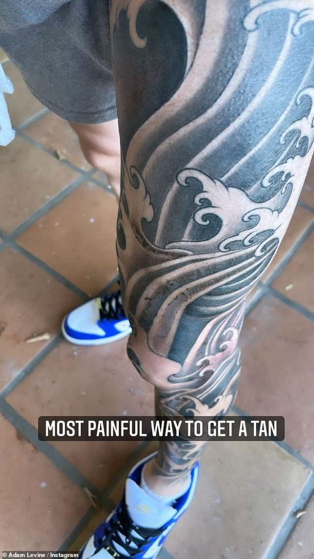 Tan: Shared another look at the full-leg artwork, adding the caption, 'The most painful way to tan'