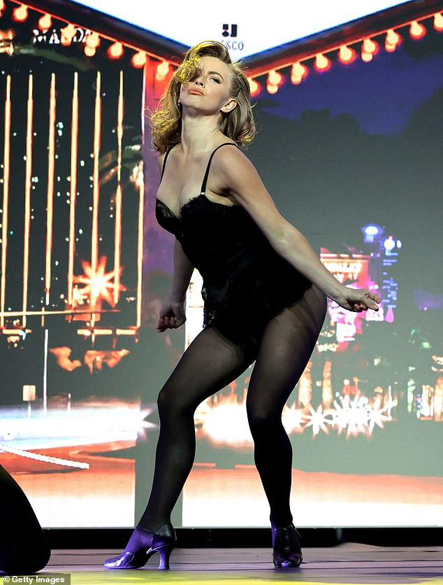 Performance: Along with presenting the award to her idol, Hough performed a dance routine on stage in a skimpy black onesie with black stockings and black heeled boots