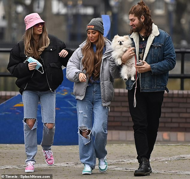 Friendship: The couple couldn't keep their hands off each other as they were joined by Francesca's dog, Romie, and her hair stylist pal, Chris Georges, on the outing