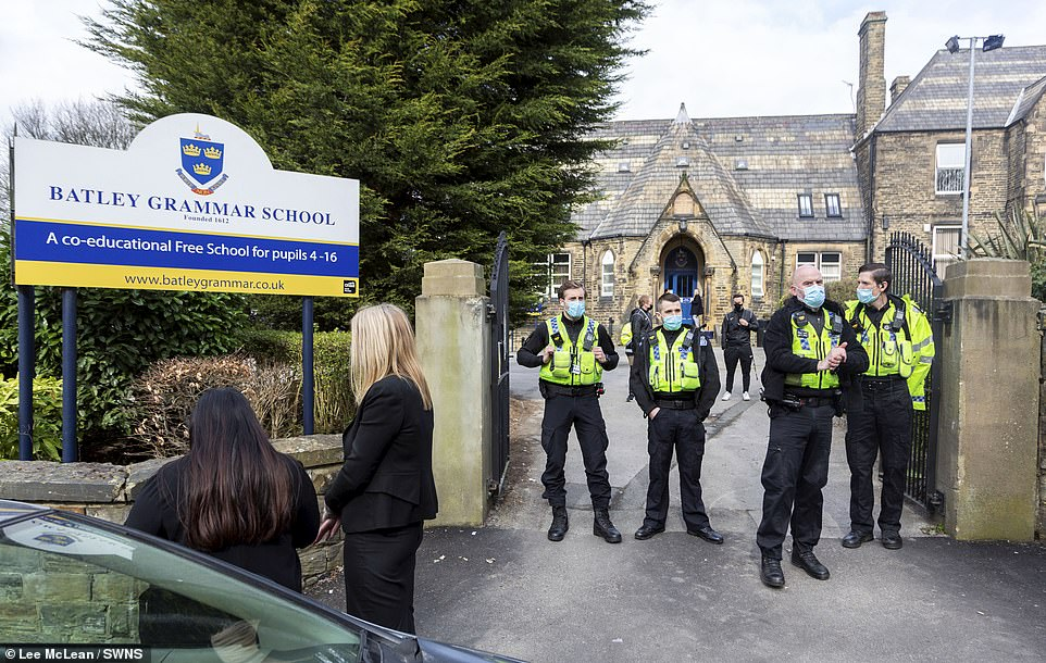 Batley Grammar School had to delay its opening and told pupils to stay at home amid chaotic scenes at its gates this morning
