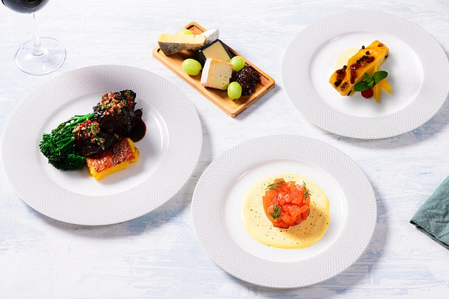 British Airways is rolling out a cook-at-home meal kit that mirrors the airline's first-class dining experience. Pictured are the DIY dishes that MailOnline Travel was sent (as prepared by a professional) -Loch Fyne smoked salmon,British beef cheeks in herb jus, a cheese plate anddark chocolate and orange liqueur bread and butter pudding