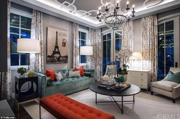 Elegant and sophisticated - The spacious home features chandeliers and decorative high ceilings