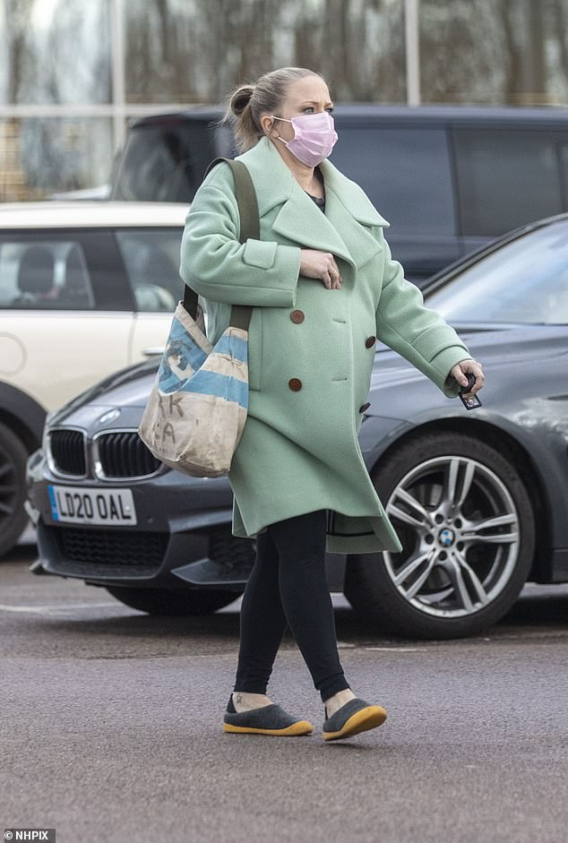 Bumping along: Actress Kellie Bright, 44, debuted her blossoming baby bump as she stepped out to refuel her car while running errands on Thursday